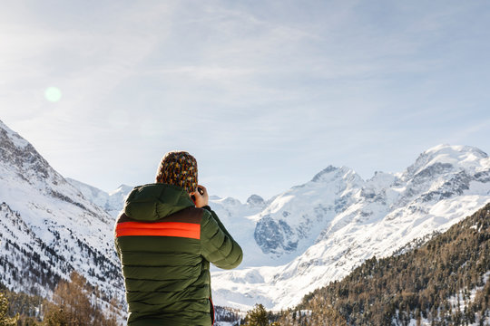 Man taking a picture of the Morteratsch glacier