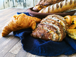 Fototapete - Assortment of baked French bread