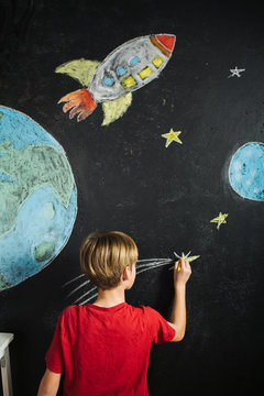Boy drawing space