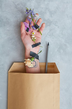Decorated hand with envelope