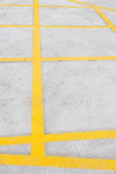 Yellow road marking on asphalt