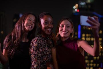 Girlfriends having fun and taking a selfie