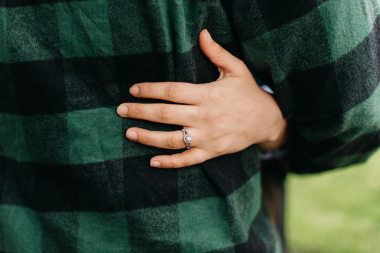 A Woman Wearing Her Engagement Ring Hugs Her Fianc?