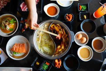 Shabu-Shabu, the tradition Japanese style hotpot which put meat and vegetable boiled in hot soup.