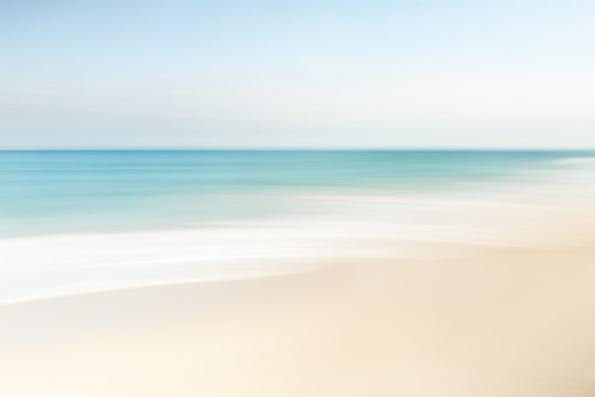 Abstract blurred waves at the beach on a clear day in spring