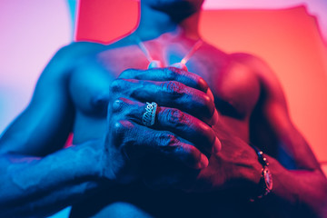 Portrait Of A Man Under Blue And Red Lights.