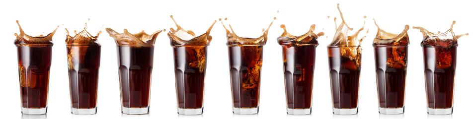 Fototapeta Splash of cola in a glass