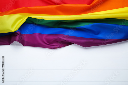 Rainbow flag on white wooden table