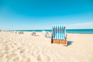 Wall Murals Caribbean Beach in Westerland with the typical german roofed beach chairs or