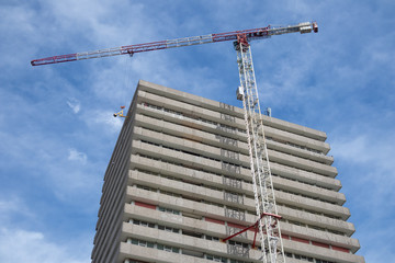 Dutch office building with working crane attached