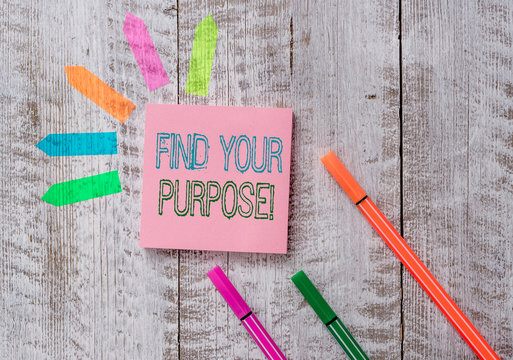 Text sign showing Find Your Purpose. Business photo text reason for something is done or for which still exists Plain note paper and line arrow stickers on the top of wooden table desk