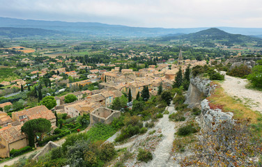 View of houses and surrounding fields in St Saturnin les Apt, France