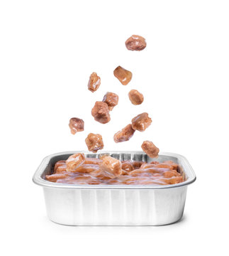 Pieces of canned wet food for dogs and cats fall in the package