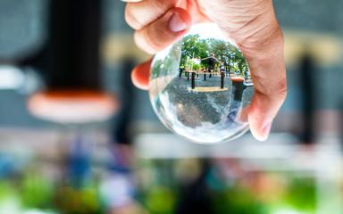 People doing sports, image taken through lensball
