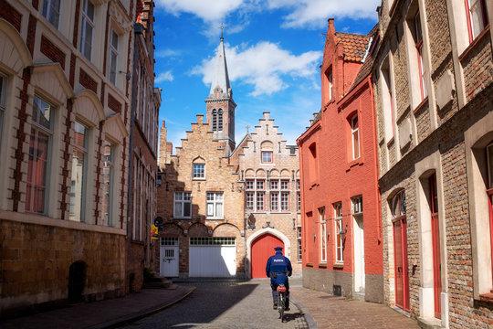 Cycling Policeman, Bruges, Belgium, Europe