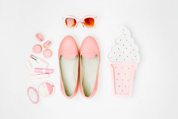 Wall Mural - Flat lay of female fashion accessories, shoes, makeup products  on pastel color background. Beauty and fashion concept