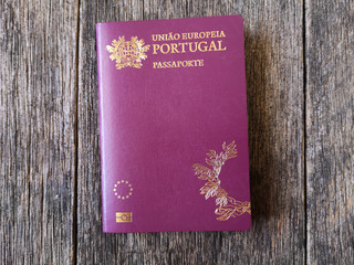 Portuguese passport with wooden background