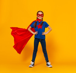 concept of child superhero costume on yellow background