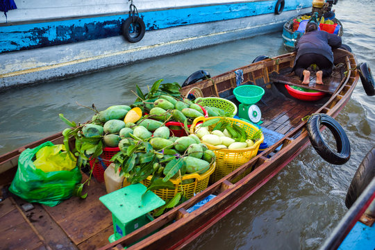 Can Tho, Vietnam - March 28, 2019: Mekong floating market in delta-trading boats at sunrise-cruise along the Mekong river