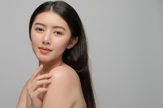 Beautiful young woman asian with clean perfect skin. Portrait model natural make up. Spa, skincare and health wellness