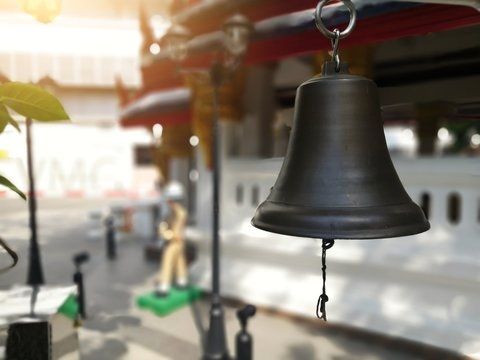The beautiful religious bell, sounded to make us feel relaxed. Closeup shot of iron bells hanging.Bells at the railway station vintage style space for text .