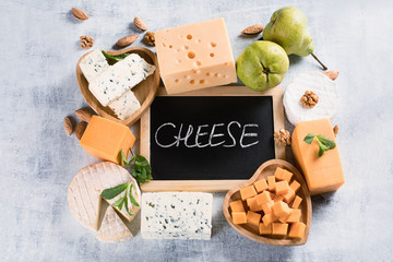Fototapete - Different kinds of cheeses