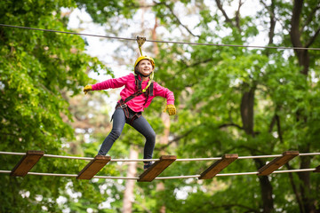 Artworks depict games at eco resort which includes flying fox or spider net. Children summer activities. Happy Little child climbing a tree.