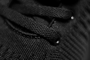 Closeup view of sport shoe. Black shoelaces closeup.