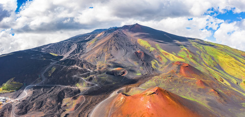 Panoramic wide view of the active volcano Etna, extinct craters on the slope, traces of volcanic activity.