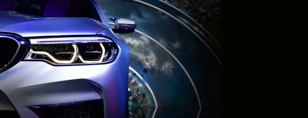 Wall Mural - Detail on one of the LED headlights modern car.copy space