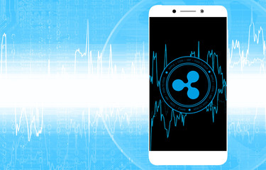 Ripple (XRP) digital crypto currency. Сoin in mobile phone on the background of stock indexes. Cyber money.