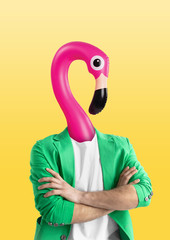 Foto op Canvas Flamingo Male body in green jacket headed by a pink swim flamingo against yellow background. Negative space to insert your text. Modern design. Contemporary art collage. Vacation, summer, resort.
