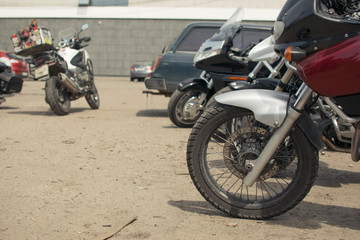 parked motorbikes in the summer in the old parking lot