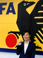 Japanese soccer referee Yoshimi Yamashita poses for a photograph during her news conference before FIFA Women's World Cup in Tokyo