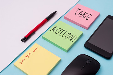 Word writing text Take Action. Business photo showcasing do something official or concerted to achieve aim with problem Note papers and stationary plus gadgets placed sideways above backdrop