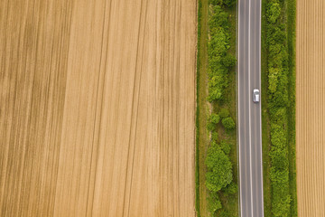 Aerial view of car moving on the road. Road traffic concept background. including copy space