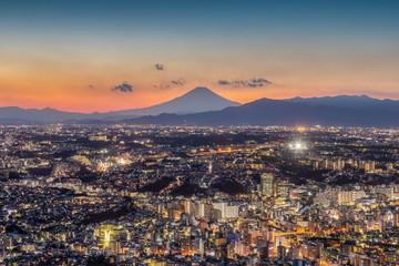 Yokohama city at night time and Mt.Fuji in sunset