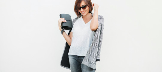 Wall Mural - Woman dressed gray and white casual outfit with checkered jacket