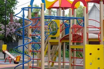 Fototapeta children's playground in the yard obraz
