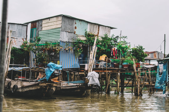 Houses and boats on the water in Mekong delta, Can Tho, Vietnam.