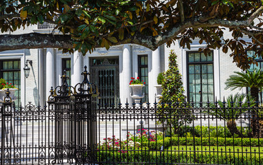 A plaster Mansion Past Wrought Iron fence in Savannah Wall mural