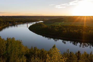 Beautiful sun rays of the setting sun over the North Saskatchewan River and Terwillegar Park...