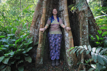 Ceiba is a genus of trees in the family Malvaceae, native to tropical and subtropical areas of the Americas  and tropical West Africa.Plump girl tourist smiling