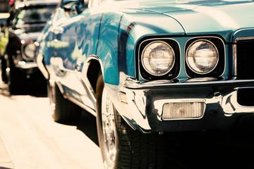 Fotomurales - Classic American car headlights close-up