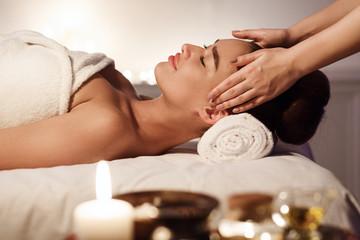 Aromatherapy. Woman Enjoying Face Massage In Spa