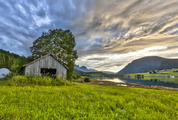 Wall Mural - Old barn in Fjord landscape Norway