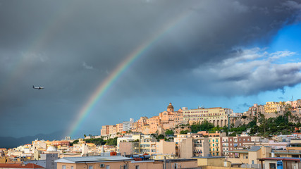 Panoramic view of Cagliari city with rainbow on the sky.