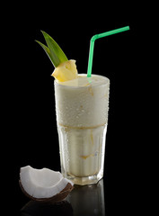 Spoed Foto op Canvas cocktail with pineapple and coconut on a black background