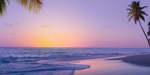 Art Beautiful sunrise over the tropical beach;  paradise summer vacation