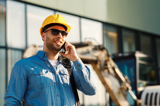 Construction engineer talking on the phone on the construction site